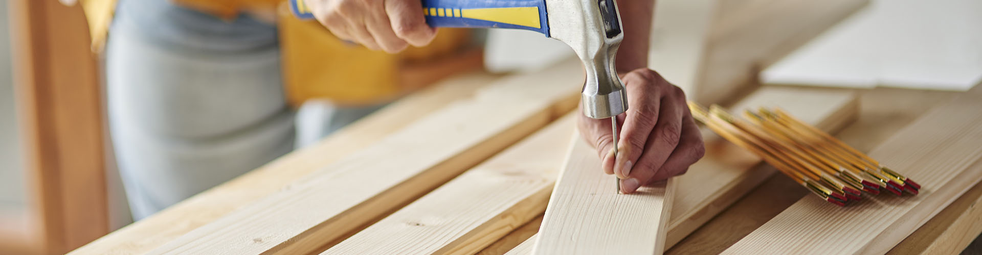 Hammering nails into wooden planks